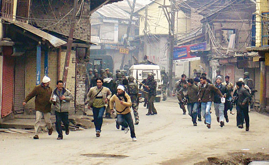 Run Away: The media men being charged in a Kashmir locality