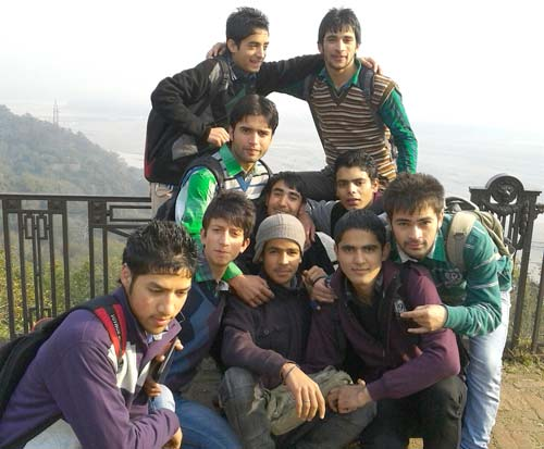 Imbisat (standing at left behind the group) with his friends in Kota, Rajasthan.