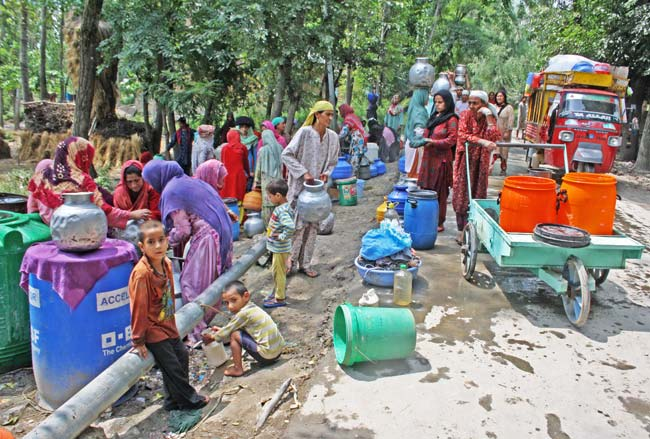 """Water Works: The area has a single irrigation canal flowing through it which is used by village womenfolk to wash clothes. """"On one side of canal women wash clothes while on other side cattle drink water,"""" said Showkat Ahmad, a private school teacher from the area."""