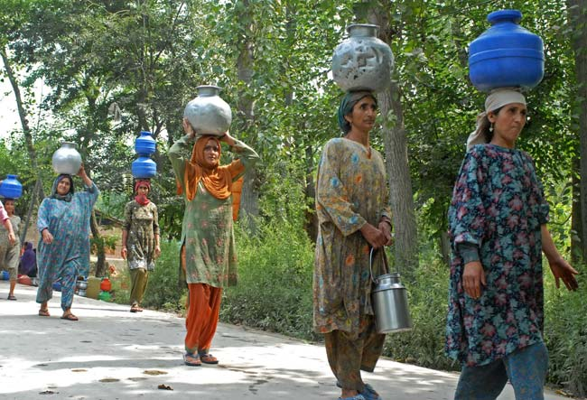 Towards Tap: Early morning, female folks of the village make beeline for fetching water. They leave behind their chores at home, just to fill their pots.