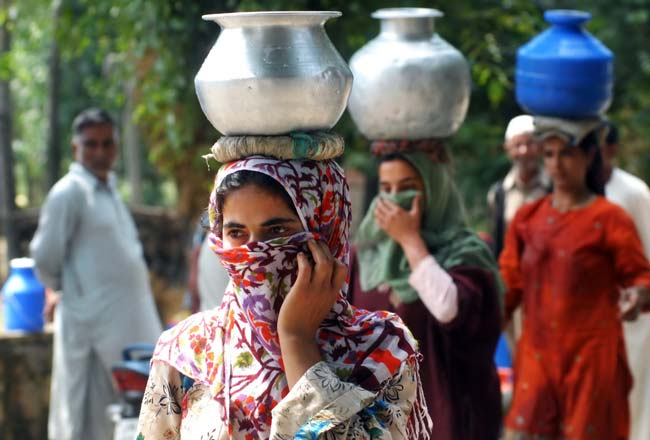 """Veiled Venture: """"Can you imagine we don't have taps in our homes,"""" says Raja, a local villager. """"But what is the fun of having taps when there is no water."""""""