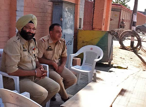 Cop Cover:  On the main road that leads to Geelani's residence, ASP Harmeet Singh has placed his makeshift office.