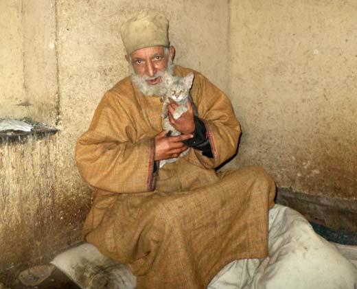 Ali Muhammad Shah with one of his pets.