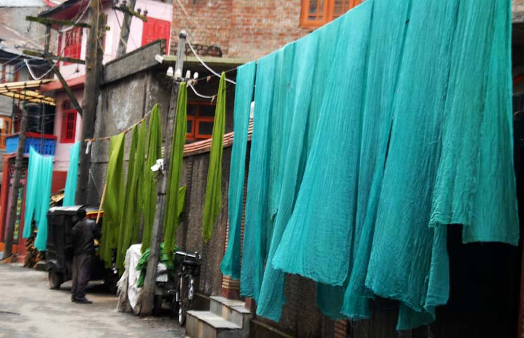 Every morning, multi-colour shawls spread out on the ropes add to the vibrant atmosphere at Rangarstop area of old Srinagar city.