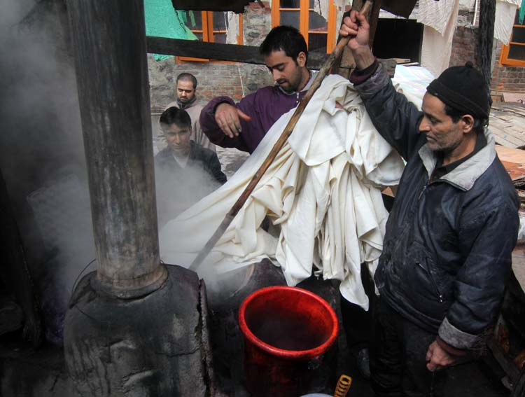 Subsequently the fabrics are immersed in dyeing pools and are stirred till they attain colour.