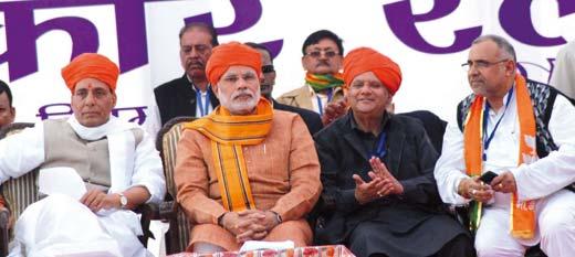 """BJP president Raj Nath Singh and its prime ministerial candidate Narendra Modi at """"Lalkaar"""" in Jammu. Pic:Asif Naik"""