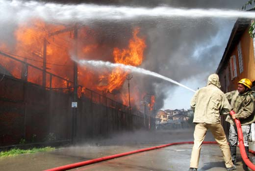 Fire fighters dousing the flames near Srinagar.