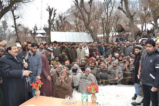 In this file photo, Peerzada Muhammad Syed is addressing a gathering of his voters in Takia Magam village of his constituency.