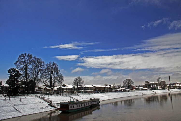 Placid Picture: As the sun managed to peep through the clouds on Wednesday, the scene near Bund in Srinagar was simply breathtaking