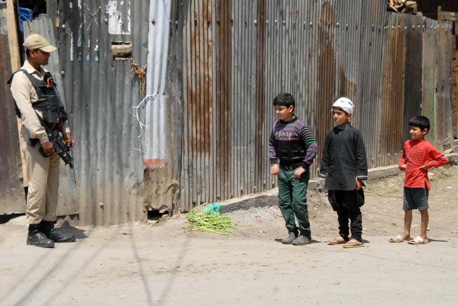 No Kidding: With adult on road, these kids without minding the manning in force, showed up in Rajouri Kadal. And behold that body language.