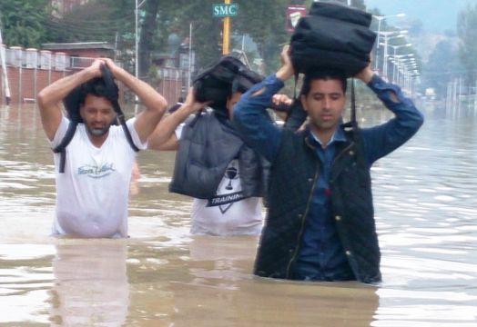 Suhail Bakshi, Operations Head, Airtel, J&K wading through waist high waters to resume MSC operations in Kashmir.