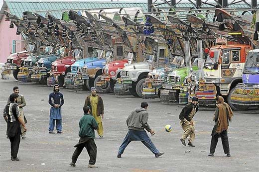 A file picture of stranded Pakistani truck drivers playing football at Slamabad. Photo Courtesy: AFP