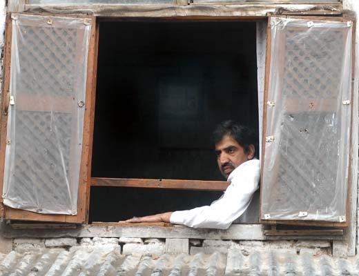 Noor Mohammad Katjoo at his residence in old city's Malaratta. Pic: Bilal Bahadur
