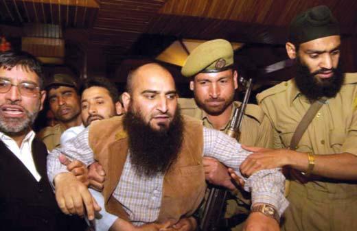 Masarat-Alam-being-taken-into-custody