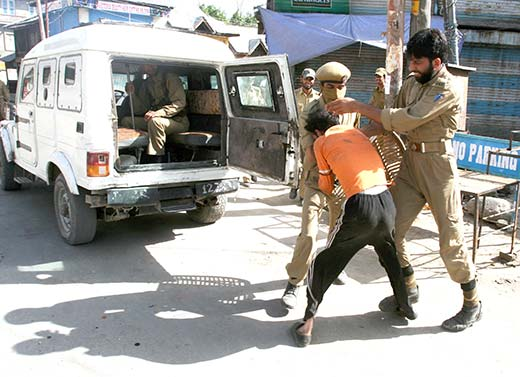 A youth being detained by policemen in Islamabad in this file photo.