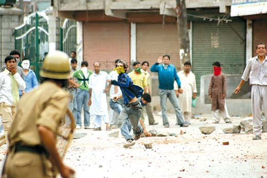 Youth engaging cops in ding dong battle during protests in Srinagar in this file photo.