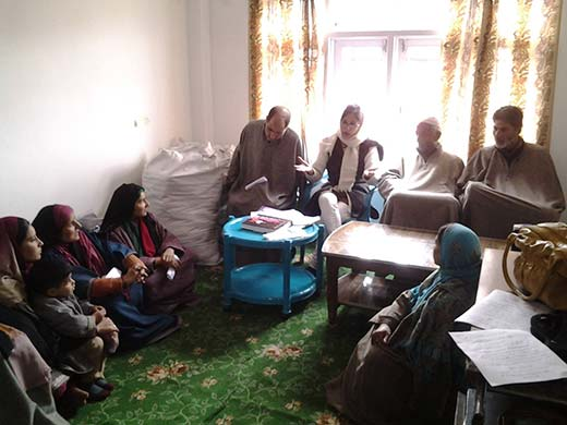 Raheela Saleem (2nd from left, sitting on chair) counselling local women in  South Kashmir's Islamabad.