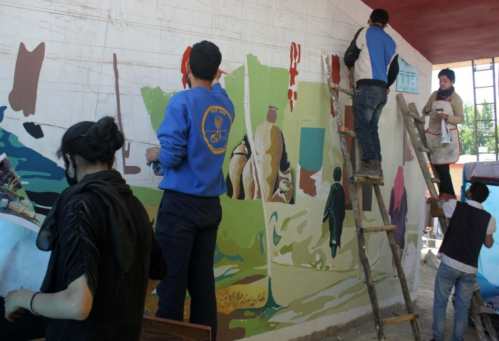 Students painting murals.