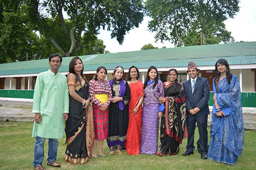SAARC students posing in their national dresses.