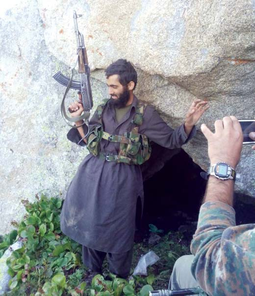 Militant-poses-with-gun-as-he-was-arrested-during-an-encounter-in-Rafiabad-area-of-North-Kashmir