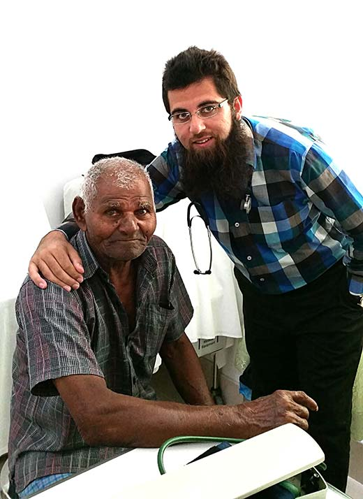 Dr-Qayum-Hamid-Changal-with-a-patient