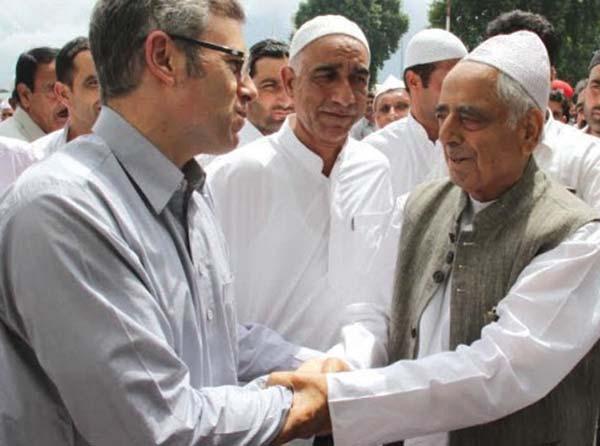 Mufti Sayeed greeting Omar Abdullah on 2015 Eid-ul-Fitr at Dargah, Hazratbal.