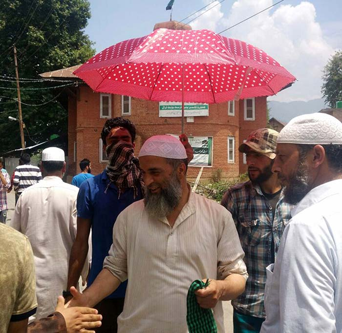 In Tral, everbody wants to shake hands with Burhan's father, Muzaffar Wani.