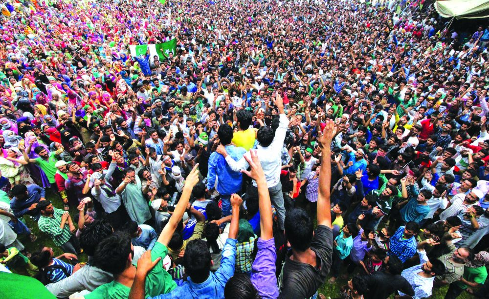 People shout slogans during funeral procession of four youths killed in Aaripanthan area of central Kashmir's Budgam district. People in thousands attended the funeral prayers PHOTO BY BILAL BAHADUR