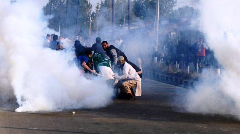 Men in uniform fired tear gas shells on the funeral of Junaid Ahmad Akhoon, 12 year old school boy, on Oct 8th 2016 morning near Aali Masjid Srinagar. (KL Image: Bilal Bahadur)