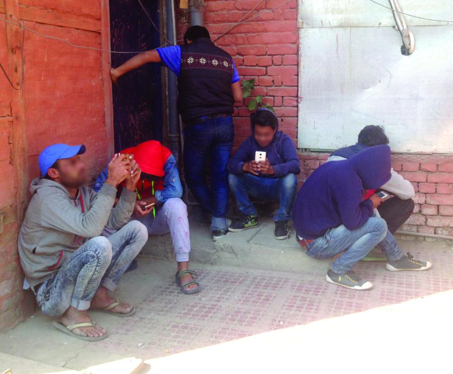 Boys using wifi in Press Colony.